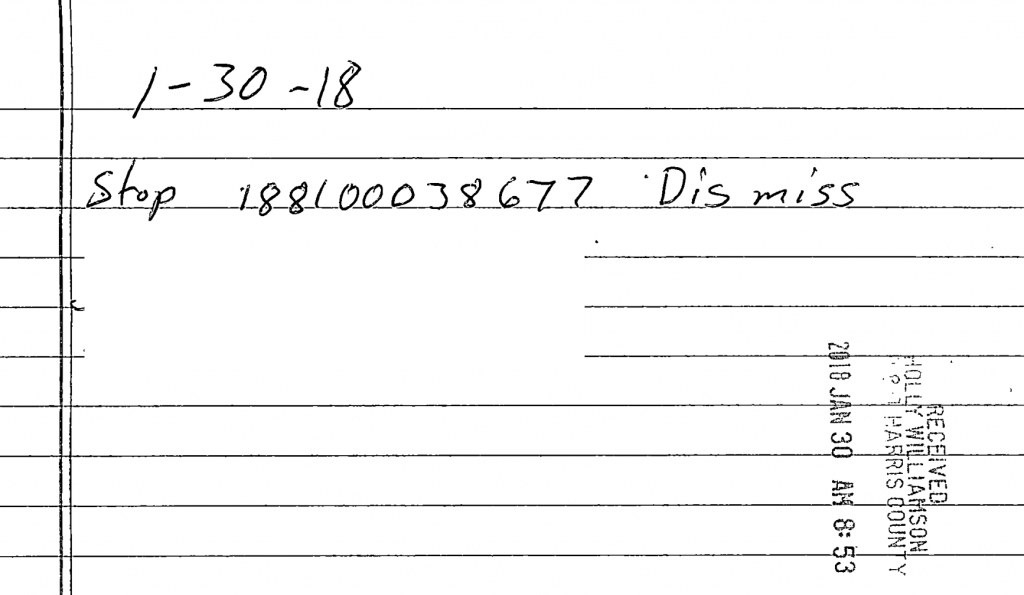 redacted image from court filings showing handwritten order to dismiss